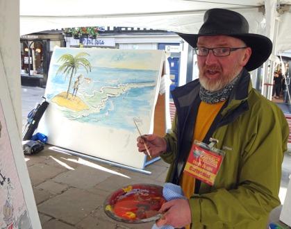 drawing a big board at shrewsbury cartoon festival 2016