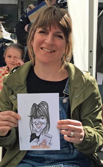 A happy customer for caricaturist John Roberts