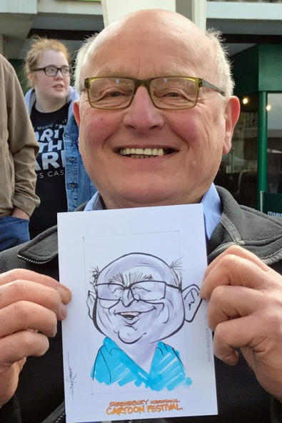 a happy customer with his caricature